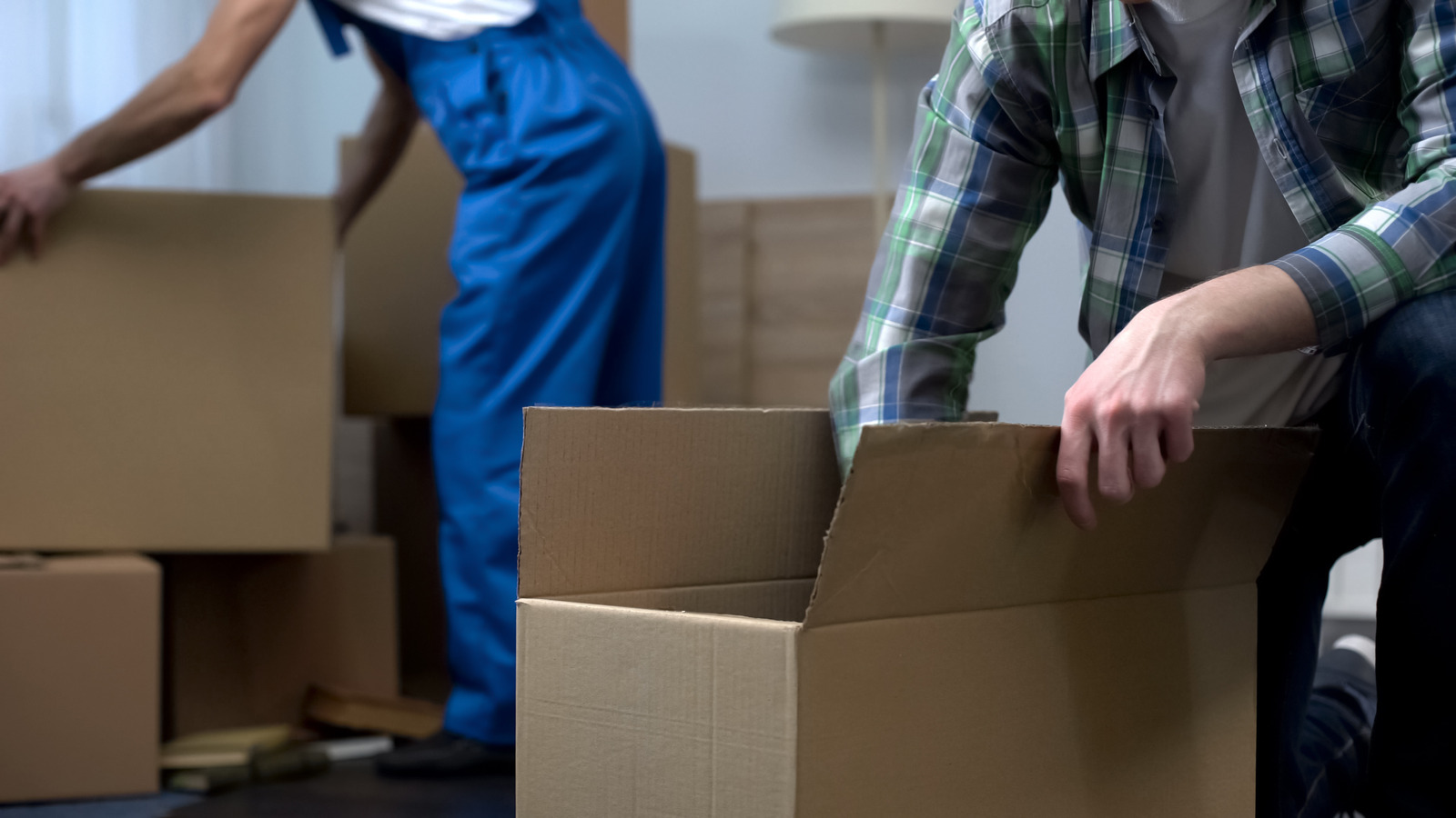 two people packing boxes