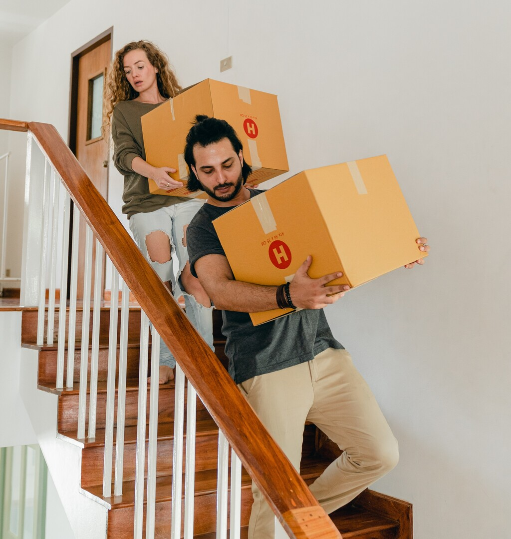 man-woman-carrying-boxes